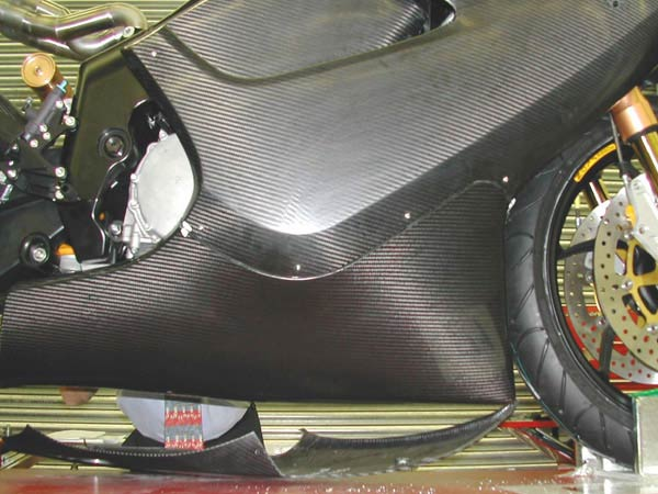 Close of of side fairing and belly pan fitted to the bike